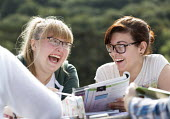 Sixth form students studying outside, Clevedon school, Clevedon. - Paul Box - 2010s,2013,Academies,Academy,adolescence,adolescent,adolescents,assisting,child,CHILDHOOD,children,communicating,communication,conversation,conversations,dialogue,discourse,discuss,discusses,discussin