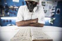 A surfboard shaper at work. - Paul Box - 2010s,2013,Board,by hand,craft,craftsman,dust,dusty,EBF,Economic,Economy,employee,employees,Employment,face mask,face masks,hazard,hazardous,hazards,health,job,jobs,lbr,male,man,mask,masked,masks,MATE