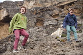 Boys playing with their dog on a cliff, scrambling down the rocks, The Algarve, Portugal - Paul Box - 2010s,2013,adolescence,adolescent,adolescents,animal,animals,beach,beaches,big,boy,boys,brother,brothers,canine,child,CHILDHOOD,children,cliff,cliffs,COAST,coastal,coasts,dog,dogs,edge,having fun,holi
