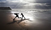 Brothers playing on the beach, The Algarve, Portugal - Paul Box - 23-02-2013