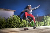 A skateboarder, The Algarve, Portugal - Paul Box - 2010s,2013,adolescence,adolescent,adolescents,boy,boys,brother,brothers,child,CHILDHOOD,children,EXTREME,having fun,holiday,holiday maker,holiday makers,holidaymaker,holidaymakers,holidays,jump,jumpin
