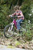 A girl riding her mountain bike, Wrexham, North Wales. - Paul Box - ,2010s,2013,activities,bicycle,bicycles,BICYCLING,Bicyclist,Bicyclists,bike,bikes,child,CHILDHOOD,children,country,countryside,cycle,cycles,cycling,Cyclist,Cyclists,female,females,girl,girls,holiday,h