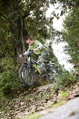 A boy riding his mountain bike, Wrexham, North Wales. - Paul Box - 2010s,2013,activities,bicycle,bicycles,BICYCLING,Bicyclist,Bicyclists,bike,bikes,boy,boys,child,childhood,children,country,countryside,cycle,cycles,cycling,Cyclist,Cyclists,holiday,holiday maker,holid