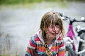 A young girl in tears having fallen off her bike and hurt her leg. Wrexham, North Wales - Paul Box - 15-09-2013