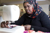 A Somali woman in a sewing class at the Wordsworth Community Centre, Southmead, Bristol - Paul Box - 2010s,2013,african,apparel,BAME,BAMEs,black,BME,bmes,centre,cities,city,clothes,clothing,communities,community,Diaspora,diversity,dress,ethnic,ethnicity,FEMALE,foreign,foreigner,foreigners,hajib,hajib