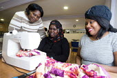 A Somali woman in a sewing class at the Wordsworth Community Centre, Southmead, Bristol - Paul Box - 16-04-2013
