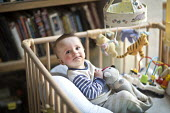 A one year old boy plays in his playpen. Bristol - Paul Box - 16-05-2013