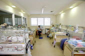 The Neonatal Intensive Care Unit at Southmead Hospital, Bristol. - Paul Box - 2000s,2006,babies,baby,bed,bedding,beds,Bristol,care,carer,carers,caring,carries,carry,carrying,check,checking,checks,child,child care,childcare,CHILDHOOD,childminding,children,children's,cities,city,