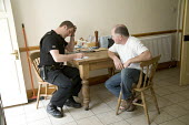 A Welsh police officer visits a home where there has been a burglary from a shed, North Wales. - Paul Box - 18-08-2006