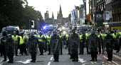 G8 protest demonstrations in Edinburgh on Monday 4th of July. Riot police stand in line on Princes street. - Paul Box - 04-07-2005