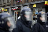 G8 protest demonstrations in Edinburgh on Monday 4th of July. Mcdonalds is surrounded by police with riot shields. - Paul Box - 04-07-2005