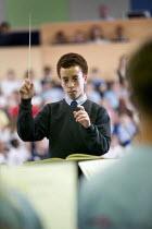 The City Academy Bristol pupils performing in a musical concert. - Paul Box - 2000s,2006,Academies,Academy,ACE,ACE arts culture,adolescence,adolescent,adolescents,attention,attentive,BAME,BAMEs,baton,batons,Black,BME,BME Black minority ethnic,bmes,boy,boys,Bristol,child,CHILDHO