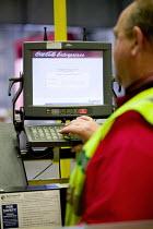 A stock picker working at Coca Cola & Cadbury Schweppes Distribution Center, London. - Paul Box - 01-07-2005