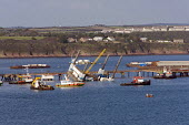 A collapsed crane, that killed a worker at the Milford Haven Liquid Natural Gas (LNG) Terminal, in Pembrokeshire. - Paul Box - (CNG),(LPG),2000s,2007,4Gas,above-ground,accidences,accident,accidental,accidents,accidents at work,Adrianus,at,boat,boats,capitalism,capitalist,Compressed,crane,cranes,damage,damaged,danger,dangerous