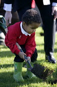 Woodland Trust's Tree For All, a children tree-planting project taking place at Fair Furlong Primary School, Bristol. - Paul Box - 2000s,2005,BAME,BAMEs,Black,BME,BME Black minority ethnic,bmes,boot,boots,boy,boys,charitable,charities,charity,child,CHILDHOOD,children,cities,city,conservation,country,countryside,dig,digging,digs,d