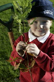 Woodland Trust's Tree For All, a children tree-planting project taking place at Fair Furlong Primary School, Bristol. - Paul Box - 2000s,2005,boy,boys,branch,branches,charitable,charities,charity,child,CHILDHOOD,children,cities,city,conservation,country,countryside,edu education,EMOTION,EMOTIONAL,EMOTIONS,eni environmental issues
