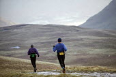 Men running on a hillside, near Helvelin, Lake District. - Paul Box - 20-11-2005