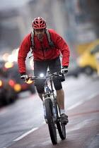A cyclist commuting to work, Bristol. - Paul Box - 07-03-2006