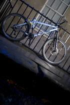 A bicycle locked to iron railing. - Paul Box - 03-11-2005