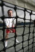 A man playing tennis, at the Welsh National Tennis Centre, Cardiff. - Paul Box - 29-04-2006