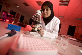 Farah Alavddin, a pupil who won the gold crest award for Wales (British Advancement of Science). Along with making it into the UK finals. for her research into Leukemia. At Howell's school, Cardiff. - Paul Box - 2000s,2006,asian,asians,BAME,BAMEs,Black,BME,BME minority ethnic,bmes,Borosilicate,child,CHILDHOOD,children,coat,coats,cultural,diversity,dress,edu education,Equipment,ethnic,ethnicity,experiment,expe