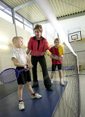 Pupils playing tennis, as part of the Physical Education and School Sport (PESS) programme, which is being initiated within Hareclive Primary School. - Paul Box - 16-11-2005