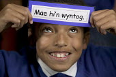 Children from a ethnic diversity, learning the Welsh language. At Kitchener Primary school, Cardiff. - Paul Box - 2000s,2005,aid,assistance,BAME,BAMEs,bilingual,bme,BME minority ethnic,bmes,boy,boys,card,cards,child,CHILDHOOD,children,class,classes,classroom,classrooms,communicating,communication,condition,condit