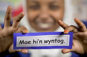 Children from a ethnic diversity, learning the Welsh language. At Kitchener Primary school, Cardiff. - Paul Box - 2000s,2005,aid,assistance,bilingual,BME minority ethnic,card,cards,child,CHILDHOOD,children,class,classes,classroom,classrooms,communicating,communication,condition,conditions,Cymraeg,dress,EAL,edu ed