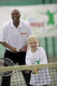Colin Jackson helps coaching children to get them interested in tennis, at the Welsh National Tennis Centre, Cardiff. - Paul Box - 29-04-2006
