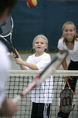 Children playing tennis, at the Welsh National Tennis Centre, Cardiff. - Paul Box - 29-04-2006