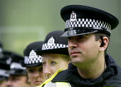 G8 protesters are surrounded by police at demonstrations in Edinburgh on Monday 4th of July. Police officers form a line. - Paul Box - 04-07-2005