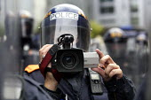 G8 protest demonstrations in Edinburgh on Monday 4th of July. A policeman videos the protesters.. - Paul Box - 04-07-2005