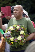 Mohammad Taj TUC Pres laying a wreath on the grave of James Hammett, Wreath Laying, Tolpuddle Martyrs Festival 2014 - Paul Box - 2010s,2014,cemeteries,cemetery,festival,FESTIVALS,floral,flower,flowering,flowers,grave,graves,graveyard,Graveyards,Hammett,headstone,James,laying,member,member members,members,PEOPLE,SWTUC,Trade Unio