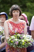 Frances O'Grady Gen Sec TUC laying a wreath on the grave of James Hammett, Wreath Laying, Tolpuddle Martyrs Festival 2014 - Paul Box - 2010s,2014,cemeteries,cemetery,FEMALE,festival,FESTIVALS,floral,flower,flowering,flowers,Frances O'Grady,grave,graves,gravestone,gravestones,graveyard,graveyards,Hammett,headstone,James,laying,member,