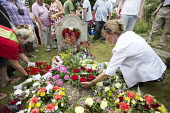 Wreath Laying, Tolpuddle Martyrs Festival 2014 - Paul Box - ,2010s,2014,cemeteries,cemetery,FEMALE,festival,FESTIVALS,floral,flower,flowering,flowers,grave,graves,gravestone,gravestones,graveyard,Graveyards,Hammett,headstone,James,Laying,member,member members,