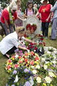 Wreath Laying, Tolpuddle Martyrs Festival 2014 - Paul Box - 2010s,2014,cemeteries,cemetery,FEMALE,festival,FESTIVALS,floral,flower,flowering,flowers,grave,graves,gravestone,gravestones,graveyard,Graveyards,Hammett,headstone,James,Laying,member,member members,m