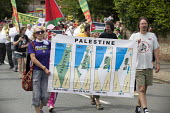 Protest against the on going attack on Gaza by Israel, Map showing the history of Palestine, 1948 to 2011, and the land grab by Israel, Tolpuddle Martyrs Festival 2014 - Paul Box - Protest,2010s,2014,activist,activists,against,attack,attacking,banner,banners,CAMPAIGN,campaigner,campaigners,CAMPAIGNING,CAMPAIGNS,COMMEMORATE,COMMEMORATING,commemoration,COMMEMORATIONS,DEMONSTRATING