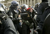 G8 protesters are surrounded by police at demonstrations in Edinburgh on Monday 4th of July. Protesters clash with riot police. A protester gets arrested. - Paul Box - 04-07-2005