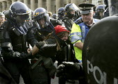 G8 protesters surrounded by police at demonstrations, Edinburgh. Protester gets arrested by riot police. - Paul Box - 04-07-2005