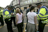 G8 protest demonstrations in Edinburgh on Monday 4th of July. Police take peoples details. - Paul Box - 04-07-2005