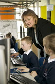 A Information Technology (IT) lesson at Seven Fields Primary School. - Paul Box - (IT),2000s,2006,building,buildings,child,CHILDHOOD,children,class,classes,classroom,classrooms,COMPUTE,computer,computers,COMPUTING,condition,edu education,education,educational,Fields,fund,Funding,fu