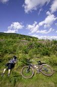 Mountain cycling in Selkirk, Scotland. - Paul Box - 2000s,2006,asleep,bicycle,bicycles,BICYCLING,Bicyclist,Bicyclists,bike,bikes,break,break time,breaks,breaktim,breaktime,cloudy,country,countryside,cycle,cycles,cycling,Cyclist,Cyclists,exercise,exerci