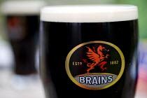 A pint of Brains beer. Stout - Paul Box - 2000s,2006,ADDICTION,ADDICTIVE,alcohol,alcoholic,ALCOHOLICS,ALCOHOLISM,beer,beers,beverage,beverages,brains,drink,drinker,drinkers,drinking,drinks,glasses,houses,LFL Leisure,LICENSED,outdoor,outdoors,