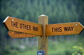A sign showing directions across Wales. This way and the other way. - Paul Box - 24-06-2006