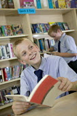 A pupil reading in the school library at City Academy, Bristol. - Paul Box - 13-07-2006