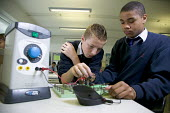Pupils learning about electronic engineering, at City Academy, Bristol. - Paul Box - 13-07-2006