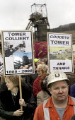 Tower Colliery,Wales the last deep pit mine in Wales closes. 239 Welsh miners scraped together 8,000 a piece to keep open a mine that British Coal had declared worthless. Miners with mixed emotions le... - Paul Box - 2000s,2008,banner,banners,capitalism,capitalist,coal,coalfield,collieries,Colliery,communities,community,deep,dust,EBF,EBF Economy,Economic,Economy,energy,final,hard hat,hat,hats,Industries,industry,j
