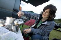 Cyclist camping Merida Bikes MTB Marathon Making and pouring a cup of tea - Paul Box - 28-05-2006