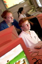 A teacher and pupil using an educational computer program, at Bedminster Down Secondary School, Bristol. - Paul Box - 02-10-2006