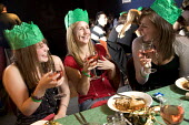 Student Union having their Christmas meal, at Jongleurs Comedy Club. - Paul Box - 2000s,2006,a,ADDICTION,ADDICTIVE,alcohol,alcoholic,ALCOHOLICS,ALCOHOLISM,beverage,beverages,catering,christmas,cities,city,club,clubs,Comedy,drink,drinking,drinks,eat,eating,edu education,EMOTION,EMOT